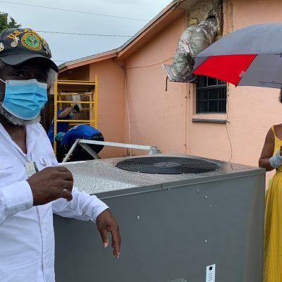 Goulds, Florida Couple Surprised with A Brand-New Air-Conditioning Unit by the Miami Dolphins and Air Pros USA